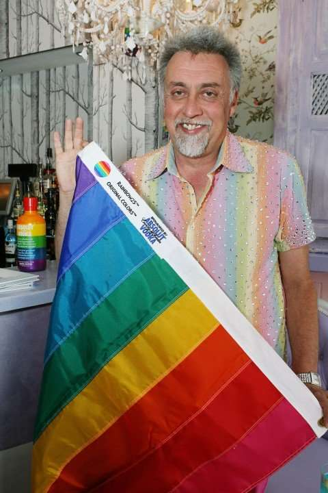 gilbertbaker-with-8-color-pride-flag